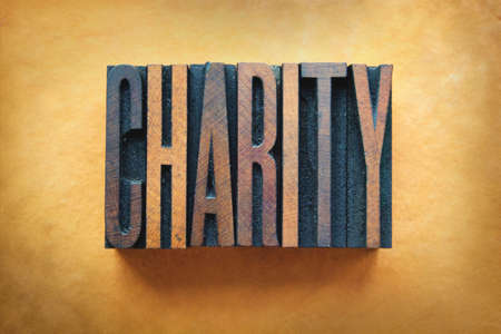 non: The word CHARITY written in vintage letterpress type. Stock Photo