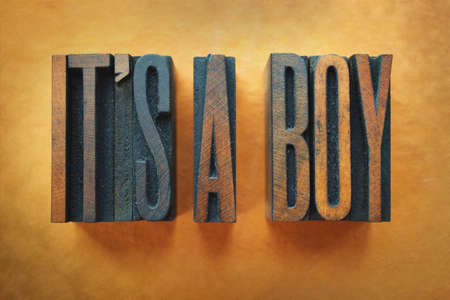 The words IT'S A BOY written in vintage letterpress type. photo