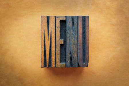 letterpress letters: The word MENU written in vintage letterpress type.