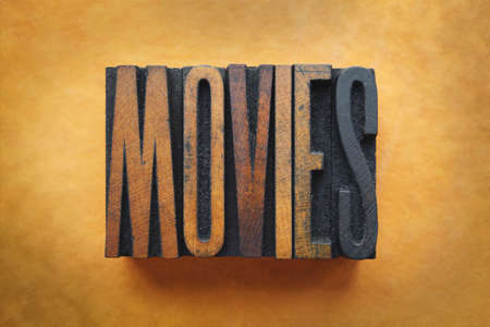 The word MOVIES written in vintage letterpress type. photo
