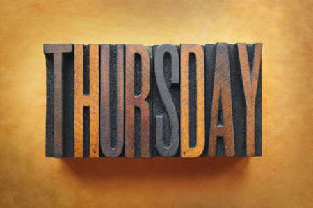 The word THURSDAY written in vintage letterpress type. Stock Photo