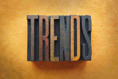 The word TRENDS written in vintage letterpress type.