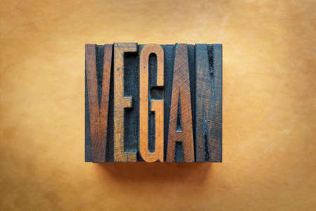 The word VEGAN written in vintage letterpress type. photo
