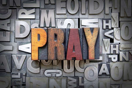 Pray written in vintage letterpress type Stock Photo - 24898198