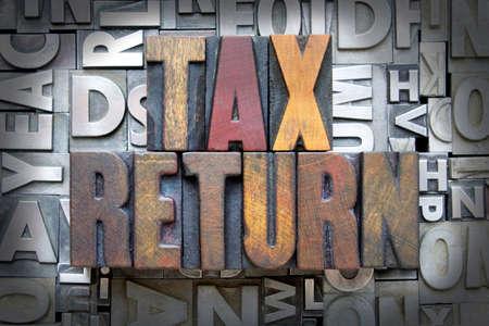 tax bracket: Tax Return written in vintage letterpress type Stock Photo