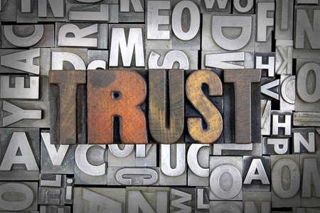 Trust written in vintage letterpress type Stock Photo - 24959426