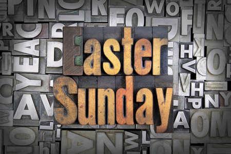 easter cross: Easter Sunday written in vintage letterpress type Stock Photo