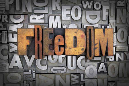 liberties: Freedom written in vintage letterpress type Stock Photo