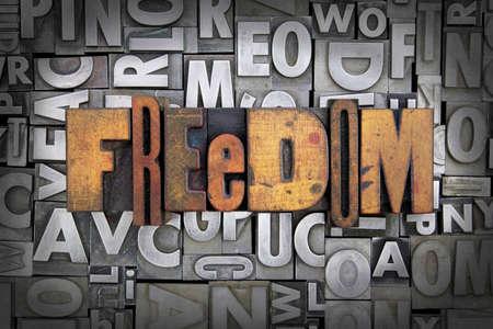Freedom written in vintage letterpress type Stock Photo - 24959433