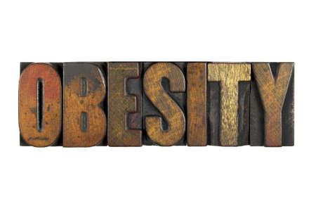 obesidad infantil: Obesidad aislado en blanco y escrito en tipo de tipograf�a de �poca Foto de archivo