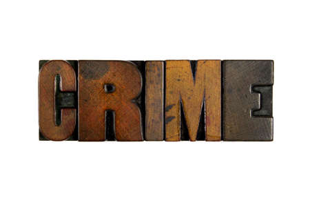 inmate: The word CRIME written in vintage wood letterpress type