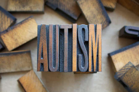 The word AUTISM written in vintage wood letterpress type photo