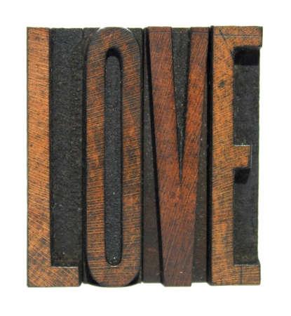 The word LOVE written in vintage letterpress type