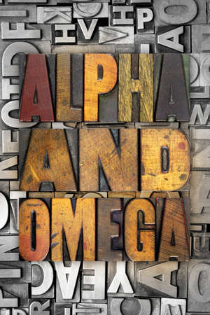 The words ALPHA AND OMEGA written in vintage letterpress type photo