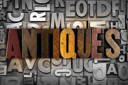 The word ANTIQUES written in isolated letterpress type Stock Photo
