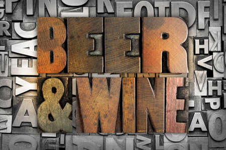 happy hour: The words BEER AND WINE written in vintage letterpress type