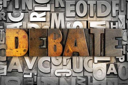 The word DEBATE written in vintage letterpress type