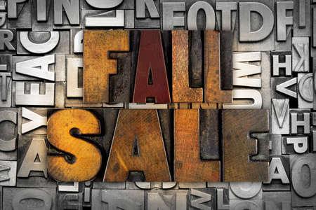 The words FALL SALE written in vintage letterpress type