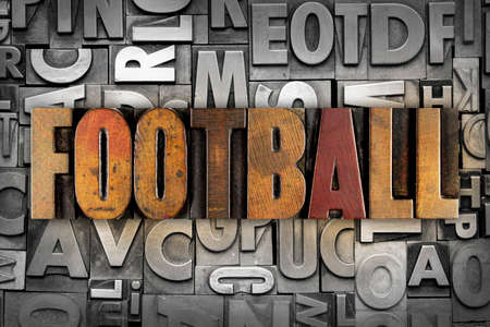 The word FOOTBALL written in vintage letterpress type photo