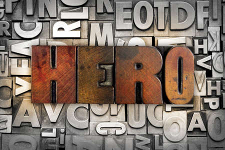 The word HERO written in vintage letterpress type photo