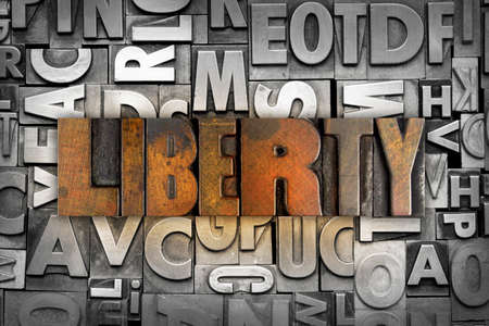 The word LIBERTY written in vintage letterpress type photo