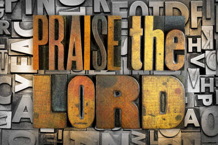 The words PRAISE THE LORD written in vintage letterpress type Banco de Imagens