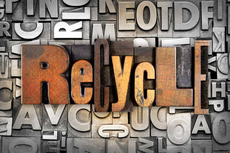 The word RECYCLE written in vintage letterpress type photo