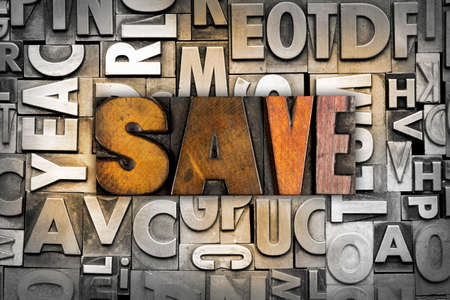 The word SAVE written in vintage letterpress type photo