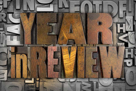 The words YEAR IN REVIEW written in vintage letterpress type photo