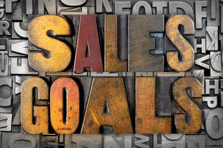The words SALES GOALS written in vintage letterpress type photo
