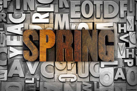 The word SPRING written in vintage letterpress type photo