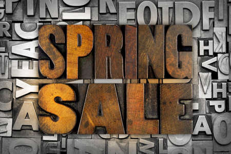 The words SPRING SALE written in vintage letterpress type photo