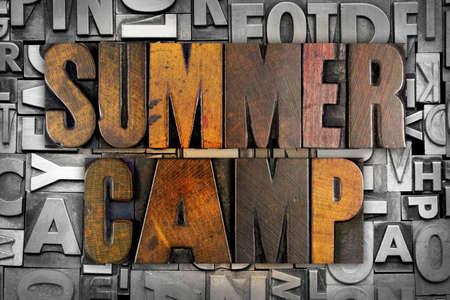 The words SUMMER CAMP written in vintage letterpress type Foto de archivo