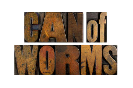Thw words CAN OF WORMS written in vintage letterpress type