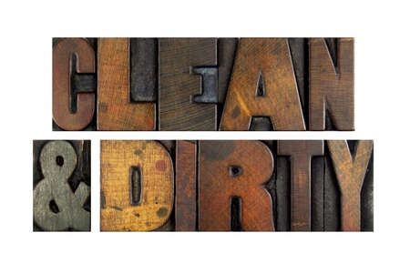 The words CLEAN AND DIRTY written in vintage letterpress type photo
