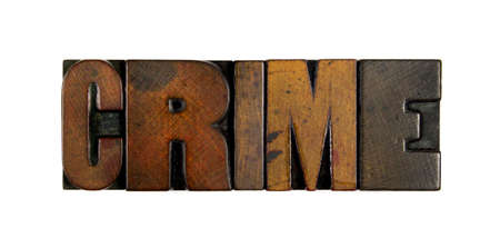 an inmate: The word CRIME written in vintage wood letterpress type