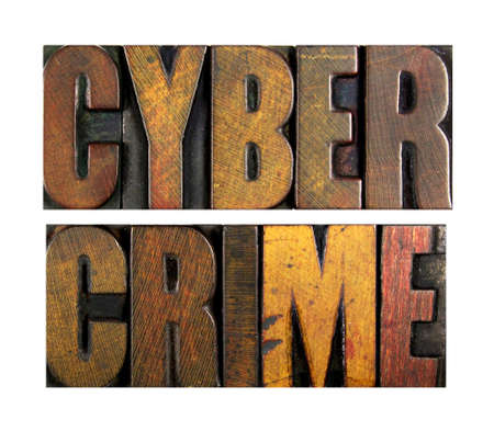 cyber crime: The words CYBER CRIME written in vintage letterpress type Stock Photo