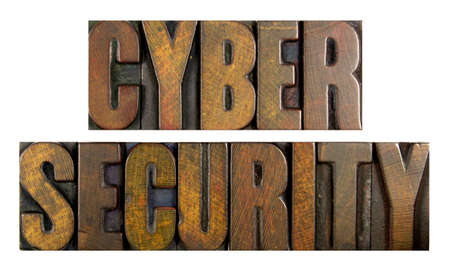 The words CYBER SECURITY written in vintage letterpress type photo