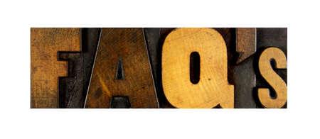 letterpress letters: The letters FAQs written in vintage letterpress type Stock Photo