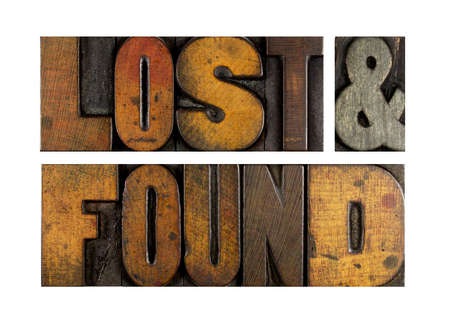 The words LOST & FOUND written in vintage letterpress type Stock Photo