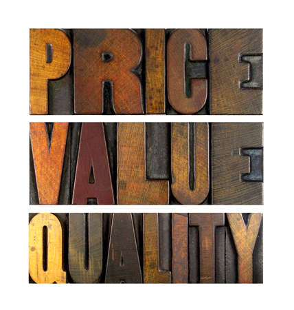 The words PRICE VALUE QUALITY written in vintage letterpress type photo