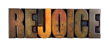The word REJOICE written in vintage letterpress type