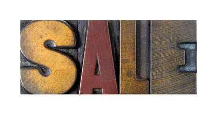 The word SALE written in vintage letterpress type photo