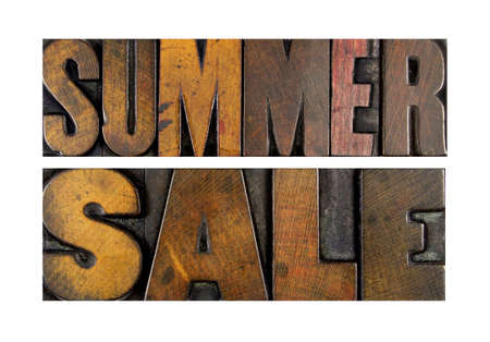 The words SUMMER SALE written in vintage letterpress type photo