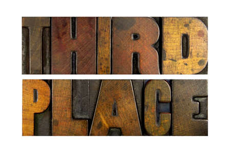 The words THIRD PLACE written in vintage letterpress type photo