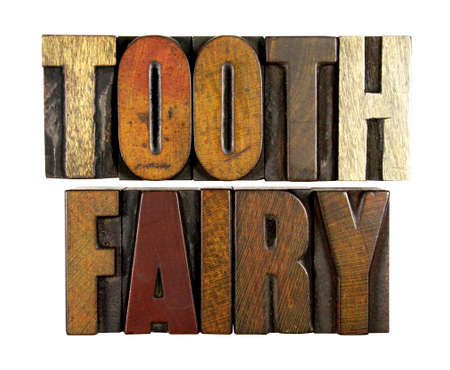 The words TOOTH FAIRY written in vintage letterpress type photo