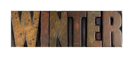 The word WINTER written in vintage letterpress type photo