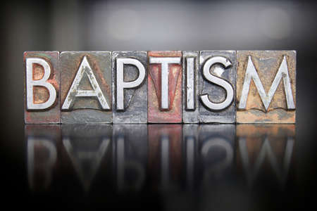 The word BAPTISM written in vintage letterpress type Stock Photo