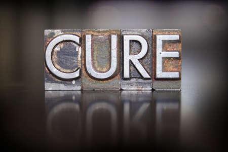 The word CURE written in vintage letterpress type Stock Photo