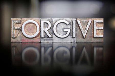pardon: The word FORGIVE written in vintage letterpress type Stock Photo
